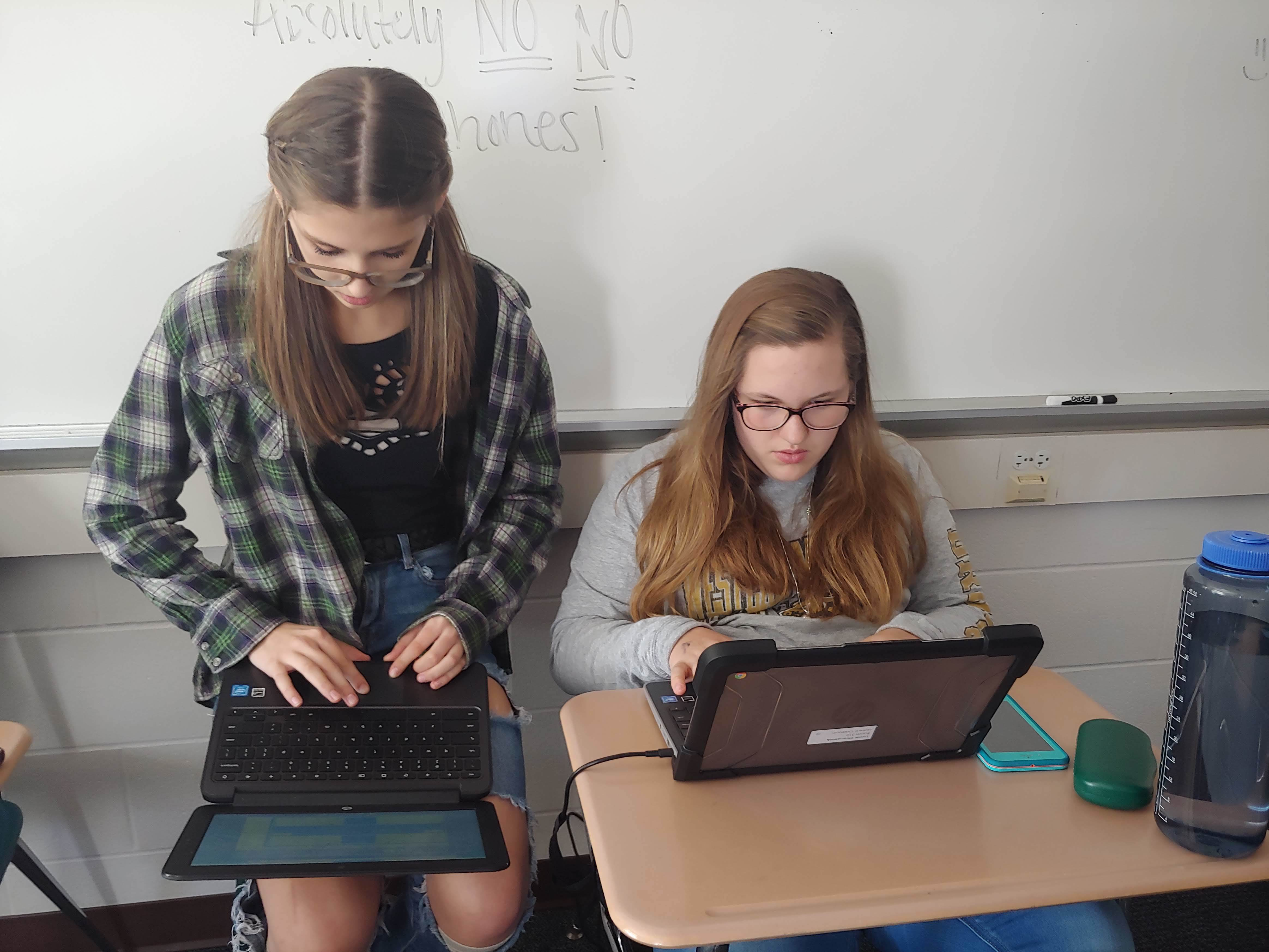 Students on the Yearbook staff working on a weekend to create pages.