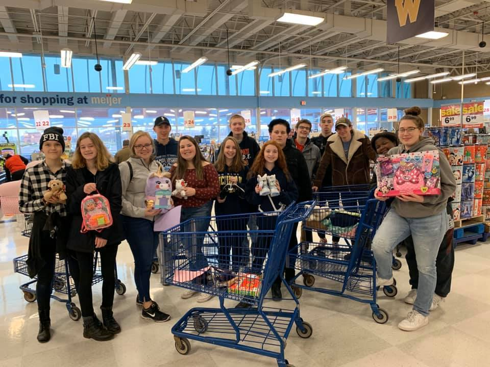 Members of the PPHS band during their shopping trip to purchase items for the family thei adopted through the Lions Club Food basket adopt-a-family program during the 2019 holiday season.
